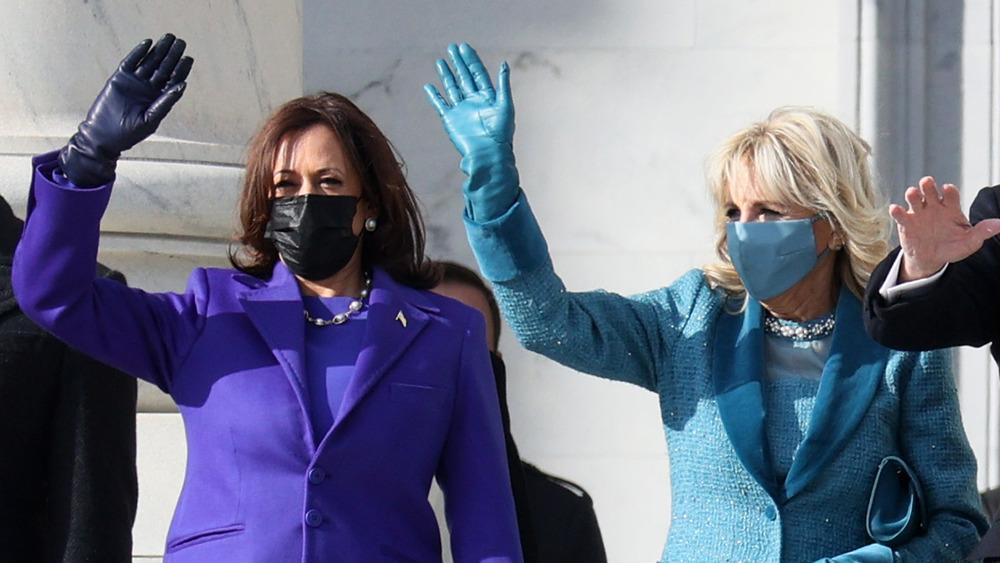 Kamala Harris and Jill Biden wave at the crowd