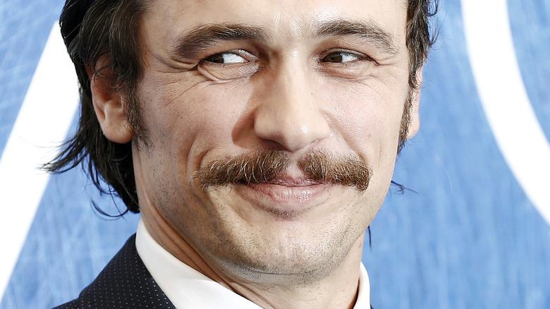 James Franco smirking on the red carpet