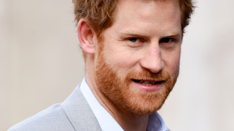 Prince Harry with slight smile looking at camera