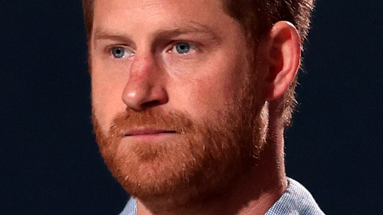 Prince Harry in front of dark background