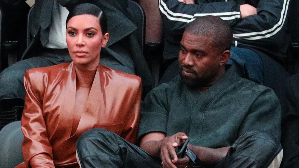Kim Kardashian and Kanye West at a basketball game