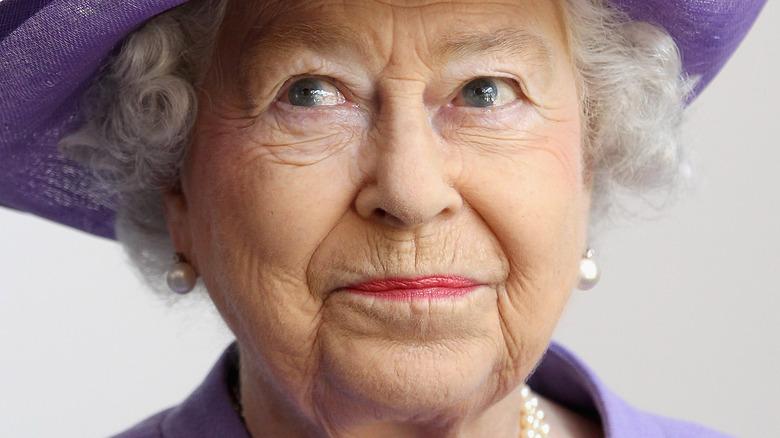 Queen Elizabeth purple hat