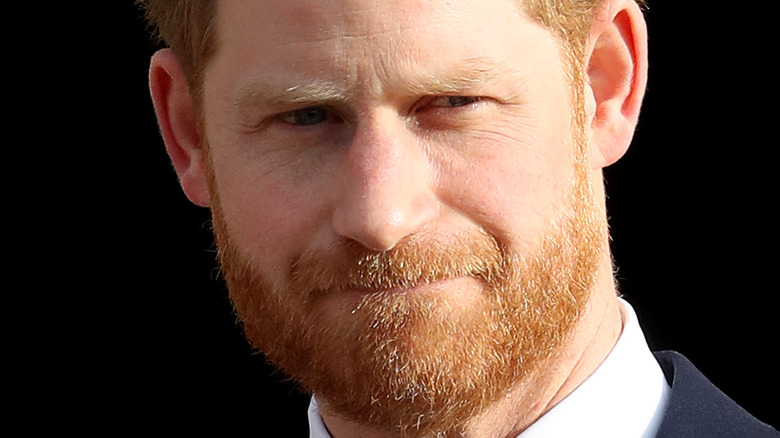 Prince Harry with a neutral expression