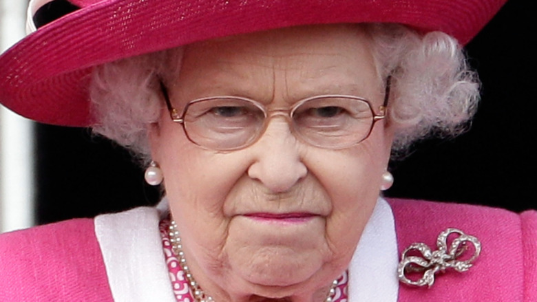 Queen Elizabeth II watches a horse race