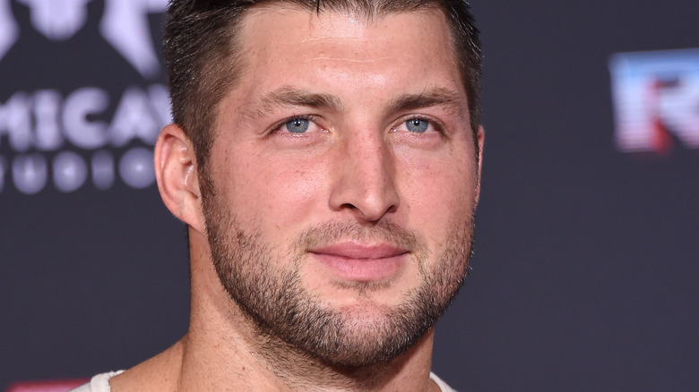 Tim Tebow smiles at an event
