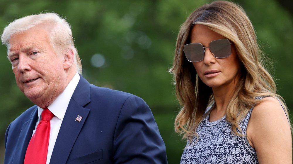Donald and Melania Trump walking