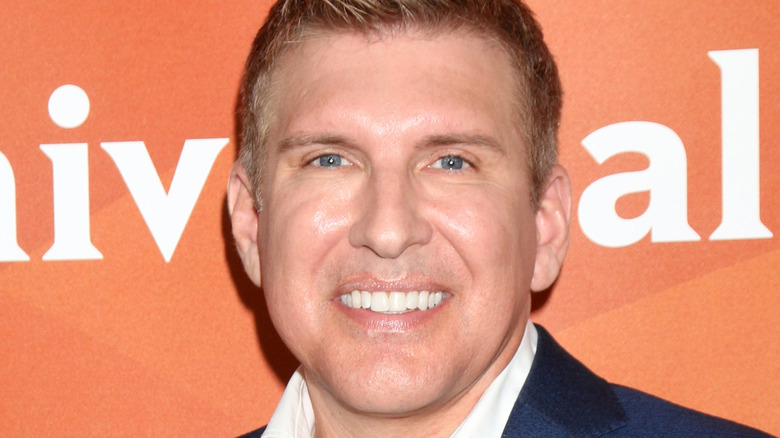 Todd Chrisley smiling at a red carpet event