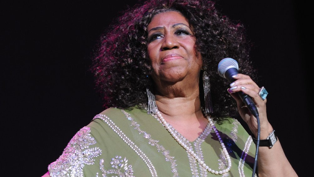 Aretha Franklin performing on stage