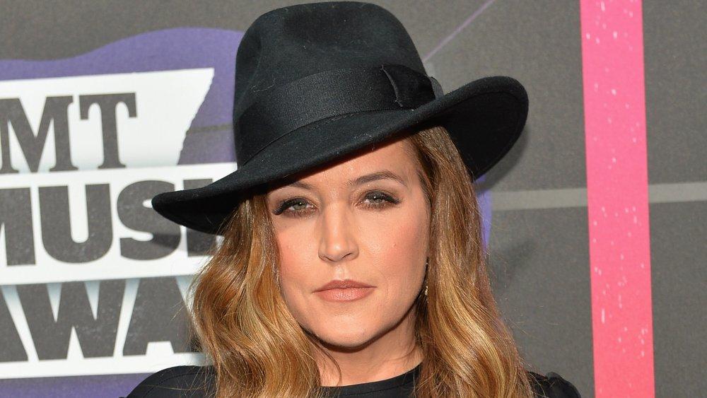 Lisa Marie Presley wearing a fedora
