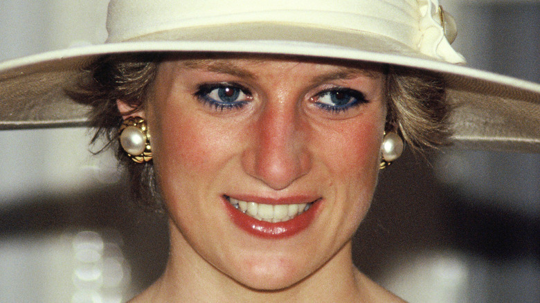 Princess Diana smiling in wide hat