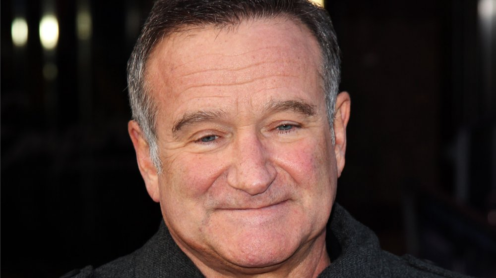 Robin Williams with a small smile