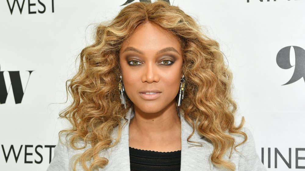 Tyra Banks posing with a neutral expression