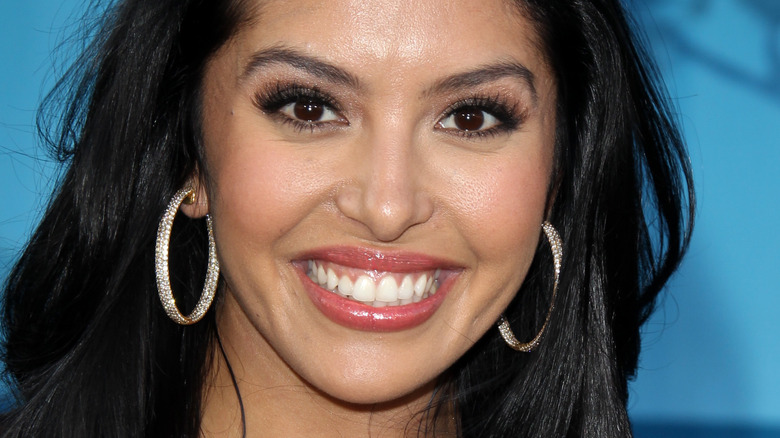 Vanessa Bryant with wide smile and hoop earrings