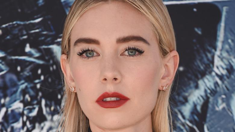 Vanessa Kirby gazing into camera wearing red lipstick