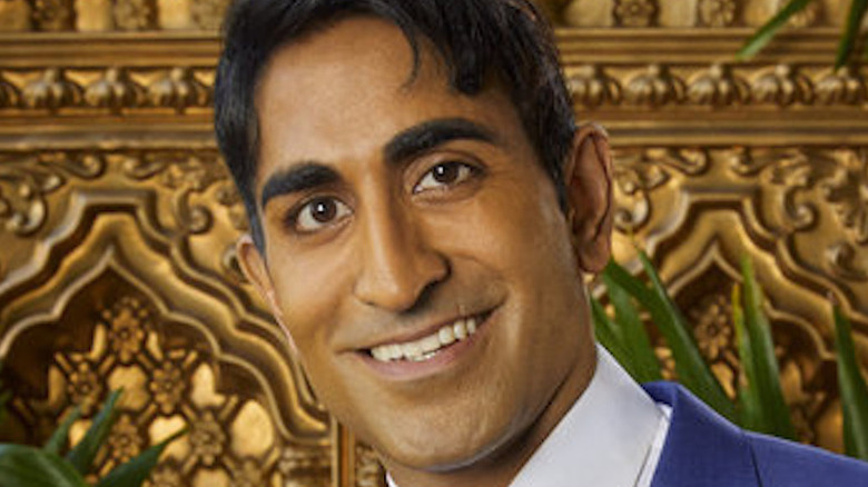 Vishal Parvani smiling on a couch