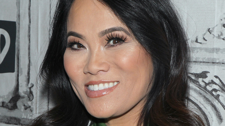 Dr. Sandra Lee, aka Dr. Pimple Popper, smiling at an event in 2012