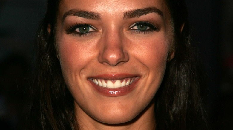 Adrianne Curry smiles at an event