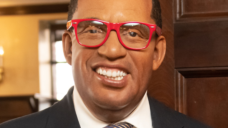 Al Roker smiling and wearing red glasses