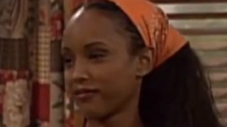 """'Boy Meets World"" screen grab, Trina McGee as Angela, wearing a green tank top and bandana"