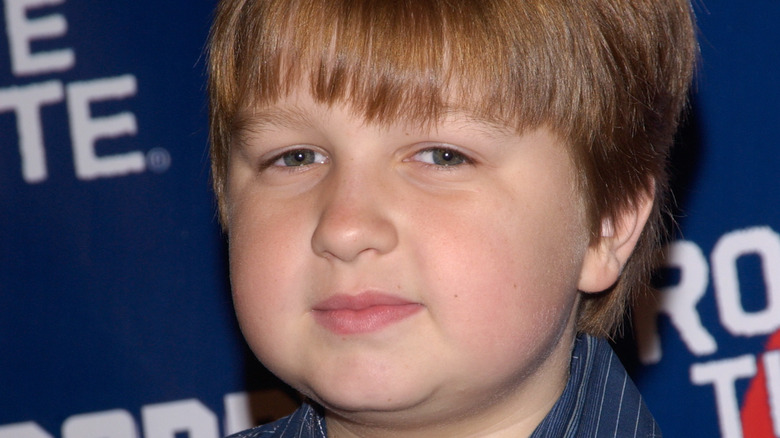 young Angus T Jones with slight smile