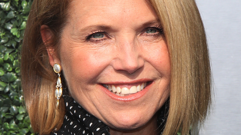 Katie Couric smiling at an event