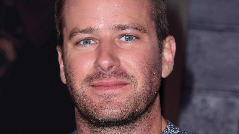 Armie Hammer smiling at an event