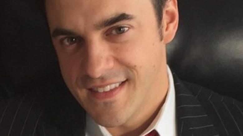 Dan Gheesling smiling in suit