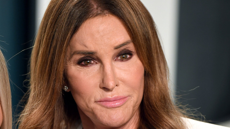 Caitlyn Jenner, looking serious, not smiling, brown hair down, 2020 red carpet, wearing white