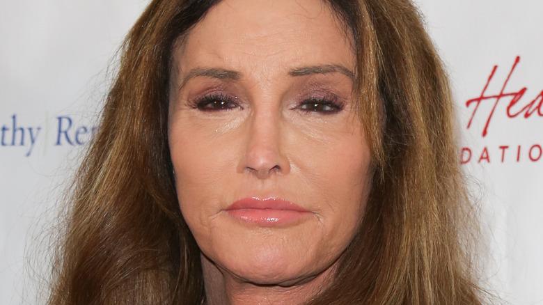 Caitlyn Jenner, 2020 red carpet, not smiling, wearing makeup, brown hair worn down