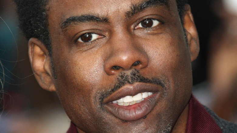 Chris Rock with a neutral expression