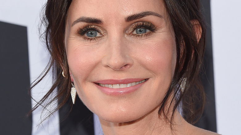 Courteney Cox smiling on red carpet at event