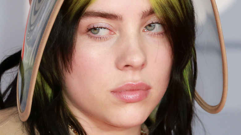 Billie Eilish on the red carpet with serious expression