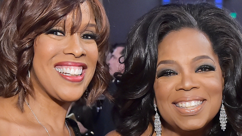 Gayle King and Oprah Winfrey smiling