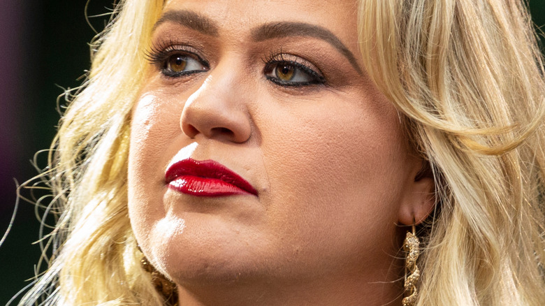 Kelly Clarkson with a neutral expression