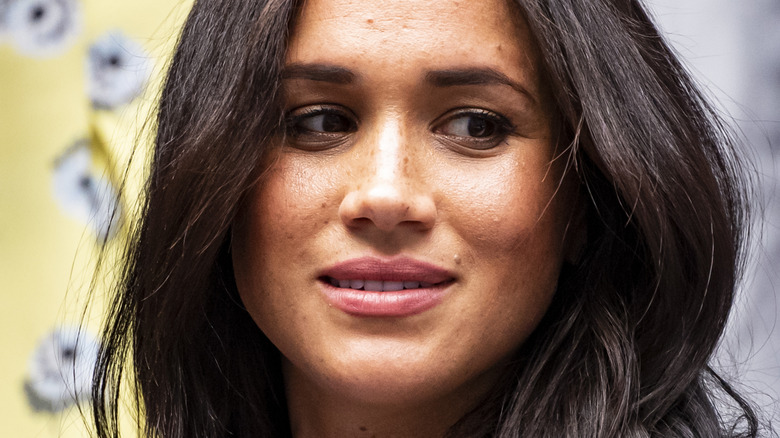 Meghan Markle with a neutral expression