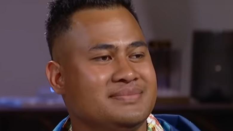 Asuelu Pulaa gives an uncomfortable smile on camera