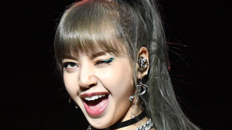 Lisa of Blackpink winks on stage
