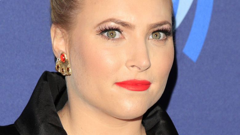 Meghan McCain with serious expression and red lipstick