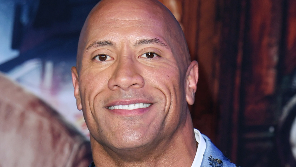 Dwayne Johnson smiling at an event
