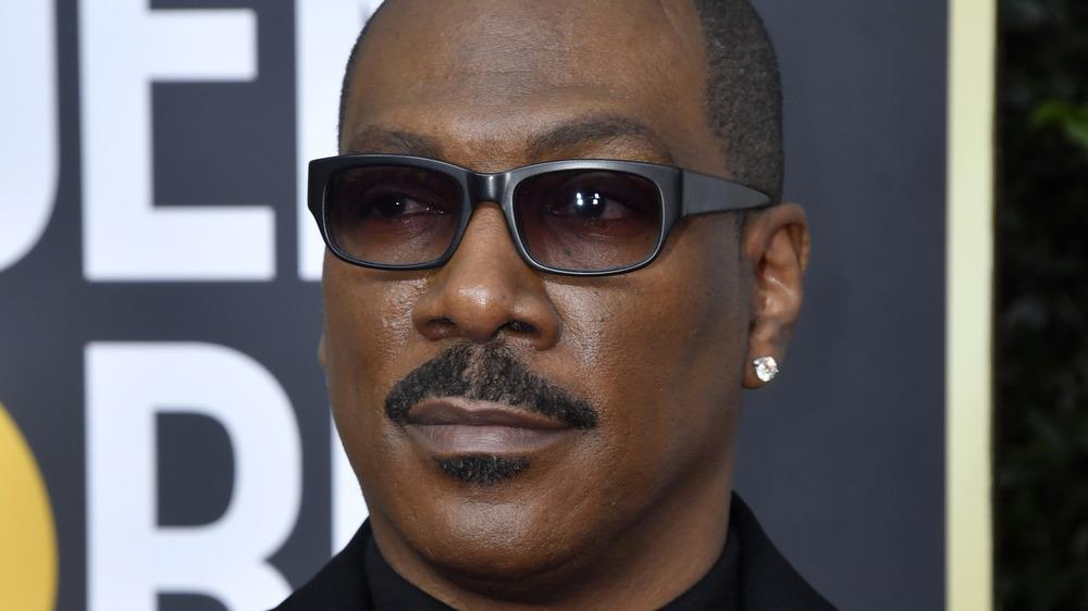 Eddie Murphy posing on the red carpet in sunglasses