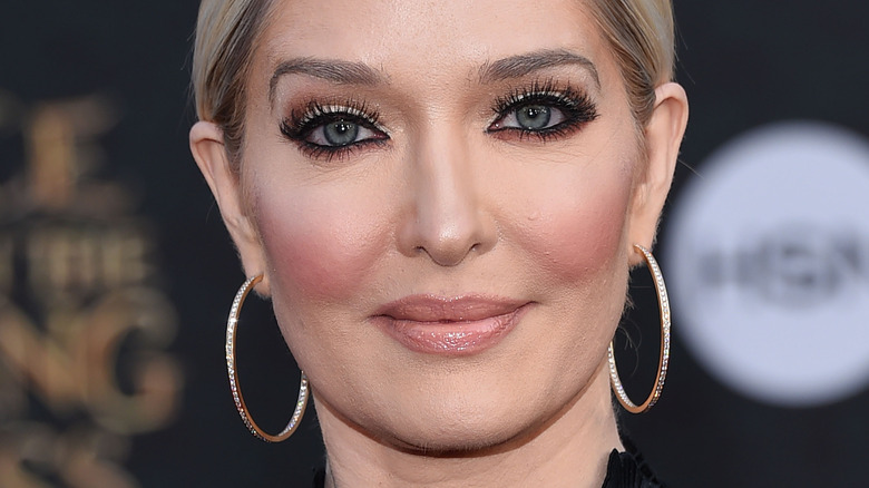 Erika Jayne smiling with updo and large hoops