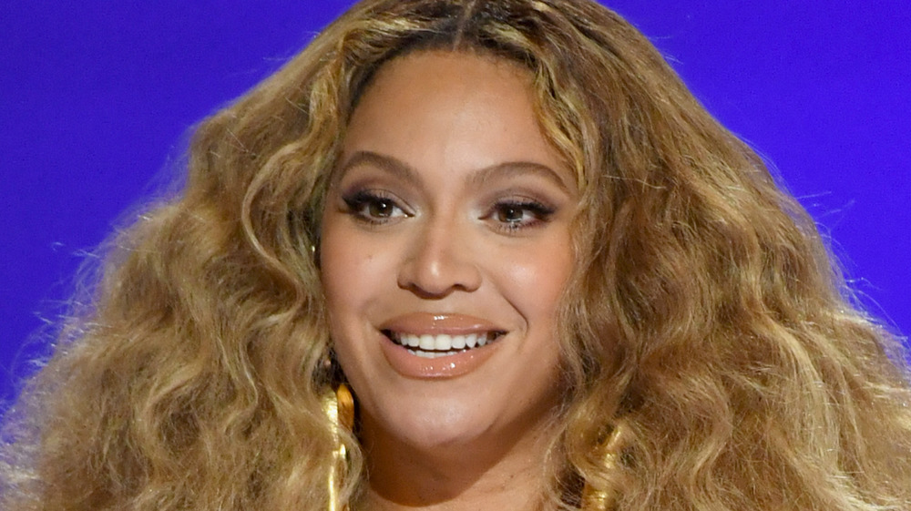 Beyoncé smiling onstage at the 2021 Grammys