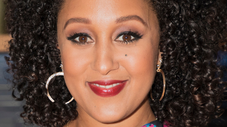 Tamera Mowry-Housley smiles at an event