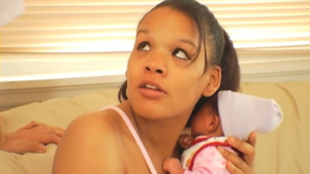 Ebony Jackson cradling her infant