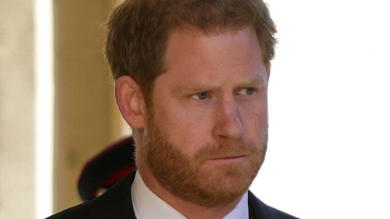 Prince Harry looks to side