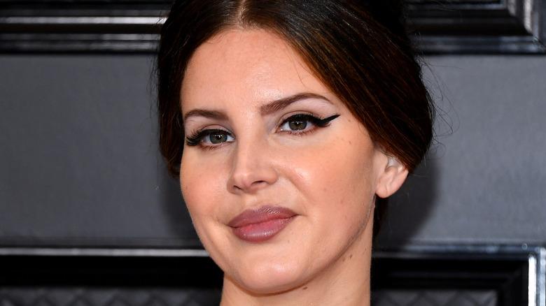 Lana Del Rey smiling on the red carpet