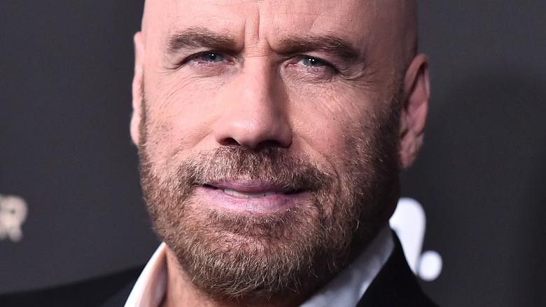 John Travolta posing on the red carpet