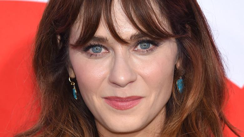 Zooey Deschanel wearing blue earrings