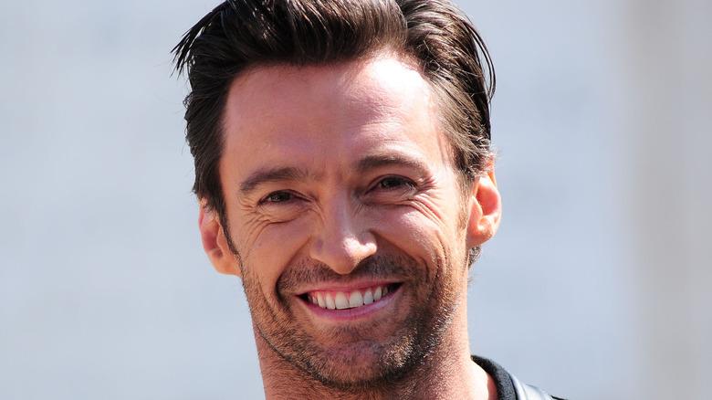 Hugh Jackman smiles at a photo call