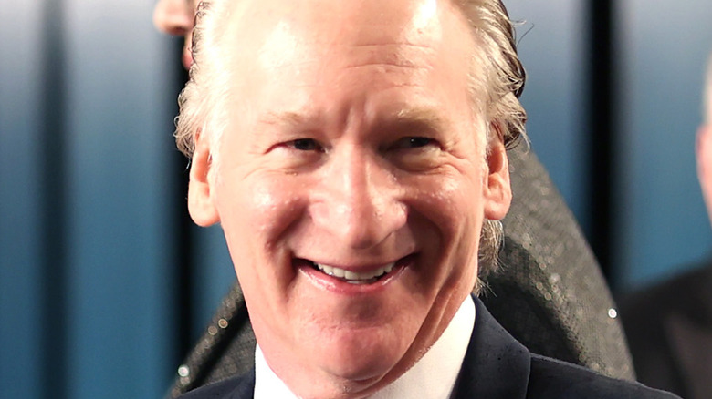 Bill Maher laughing at an Oscars party